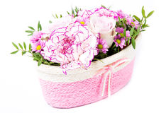 Basket of flowers. Isolated on white Stock Image