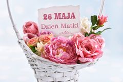 A basket of flowers for a mom with text in polish May 26th Mother day. A big wicker basket of flowers for a mom with text in polish ` May 26th Mother`s Day stock photography