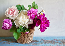 Basket with flowers. On a wooden table Royalty Free Stock Images