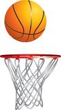 Basket flying into hoop. Isolated basketball drops into hoop Stock Photo