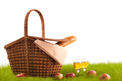 Basket with food on the grass on a white background Royalty Free Stock Images