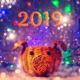 Basket in the form of a pig, the symbol of 2019 on the Chinese horoscope, on the background of lights, garland and beautiful bokeh. Celebration of the royalty free stock photos