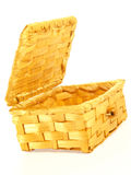 Basket in the form of trunk,. Wicker. On a white background Royalty Free Stock Photos