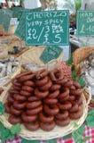 A basket of frankfurters or sausages at a farmers market. Seen in a farmers market was this basket of spicy frankfurters or sausages Stock Photo
