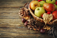 Basket with fresh apples and pears on a wooden table. Autumn background. Harvest stock image