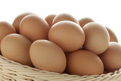Basket with fresh eggs Stock Images