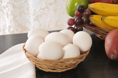 Basket of fresh eggs Stock Photos