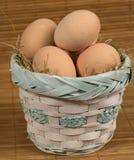 Basket of fresh eggs on a mottled background stock image