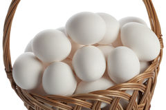 Basket with fresh eggs Stock Photos