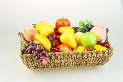Basket of fresh fruit. Basket of colorful, different fresh fruit with white studio background Stock Photo