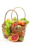 Basket of fresh fruits. Isolated on white background stock photo