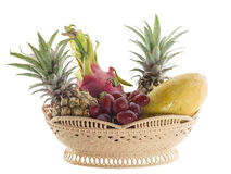 Basket of fresh fruits isolated on white Royalty Free Stock Photo