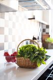 Basket with fresh greens Stock Images