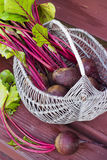 Basket of fresh harvested beetroots, beets with leaves Stock Photo