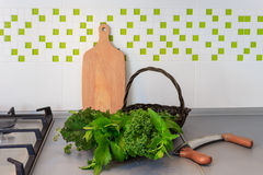 Basket with fresh herbs on kitchen top Royalty Free Stock Photos