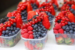 Basket with fresh juicy berries on farmer market Stock Image