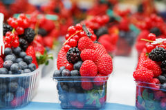 Basket with fresh juicy berries on farmer market Stock Photography
