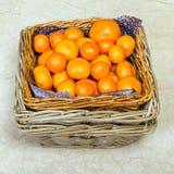 Basket of fresh mandarins Stock Photography