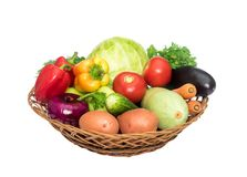 Basket with fresh mixed vegetables. On white background royalty free stock photo