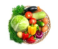 Basket with fresh mixed vegetables. On white background royalty free stock images