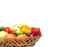 Basket with fresh mixed vegetables. On white background stock images