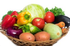Basket with fresh mixed vegetables. On white background royalty free stock photos