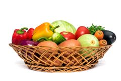 Basket with fresh mixed vegetables. On white background stock photos