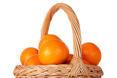 Basket of fresh oranges, mandarines or tangerines  on wh Royalty Free Stock Photo