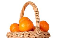 Basket of fresh oranges, mandarines or tangerines  on wh Royalty Free Stock Photo