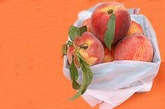 Basket of Fresh Peaches stock photo