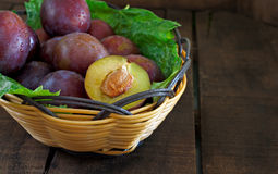 Basket of fresh plums Stock Photo