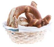 Basket with fresh Pretzels on white Stock Photo