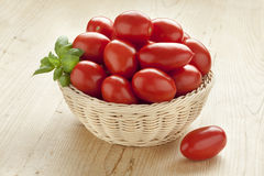 Basket with fresh red tomatoes Stock Photography