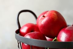 Basket with fresh ripe red apples stock photography