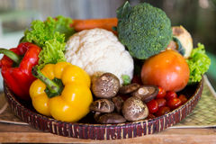 Basket of fresh ripe vegetables at kitchen Stock Photography