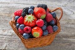 Basket with fresh seasonal berries, top view Royalty Free Stock Photo