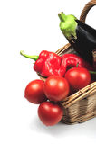 Basket with fresh vegetables. A woven basket with some fresh vegetables stock photography
