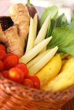 Basket of fresh vegetables. Consisting of babycorn, tomatoes, bok choi, ginger and banana Stock Images
