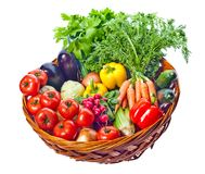 Basket with fresh vegetables. On a white background stock images