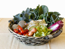 Basket of fresh vegetables on table, healthy home grown food. Wh Stock Photos