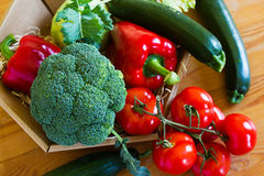 Basket with fresh vegetables on a wooden table Royalty Free Stock Photography