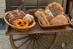 Basket of freshly baked bread in front of portable wood fired ov Stock Photo