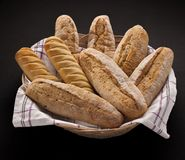 Basket with freshly baked bread. Isolated on a black background Royalty Free Stock Photography