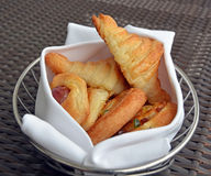 Basket of Freshly Baked Pastries including Croissants & Pain aux Stock Photography