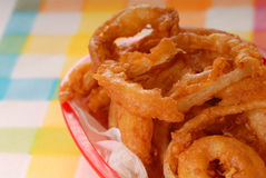 Basket of freshly made onion rings Royalty Free Stock Photography