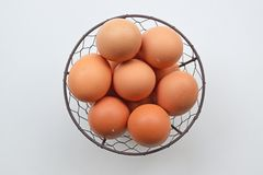 A basket of freshly produced farm chicken eggs stock images