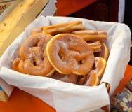Basket of fried pretzel with sugar. Stock Photo