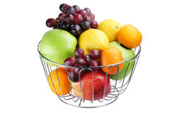 Basket with fruit. It is isolated on a white background Stock Image