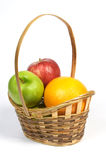Basket with fruit. Apples and grapefruit Royalty Free Stock Photography