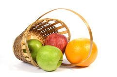 Basket with fruit. Apples and grapefruit Royalty Free Stock Photos